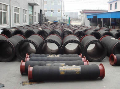 Many dredge hoses are on the ground.
