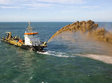 Dredge hoses are working with dredger to discharge sand.