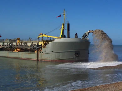 Dredge hoses are working with dredger to discharge slurry to the shore.